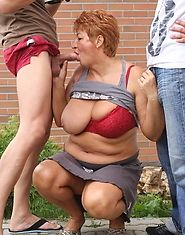 Two guys are taking turns fucking this old granny pussy