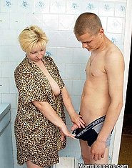 A horny mature blond gets it in the kitchen